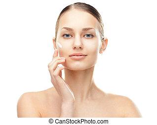 mulher jovem, com, creme cosmético, ligado, um, bochecha