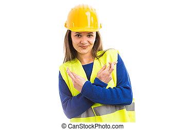 mulher jovem, engenheiro, com, boa sorte, dedos cruzaram
