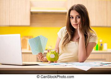 mulher jovem, esposa, em, orçamento, planificação, conceito