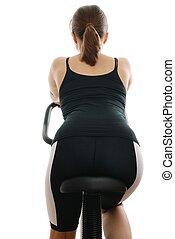 mulher jovem, montando, ligado, um, girar, bicicleta, -, costas