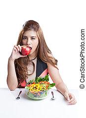 mulher jovem, morena, presente, e, comer, salada