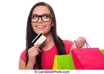 mulher jovem, planificação, lista fazendo compras