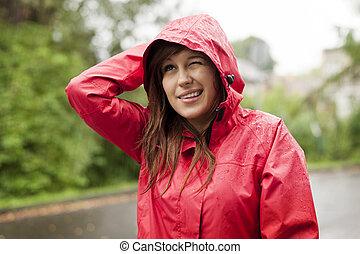mulher, jovem, raincoat