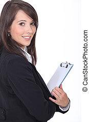 mulher jovem, segurando, notepad
