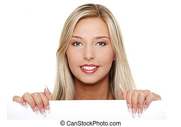 mulher jovem, segurando, um, em branco, signboard.