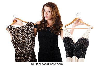 mulher jovem, tentando, novo, roupa, branco