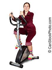 mulher jovem, trabalhar, ligado, exercycle