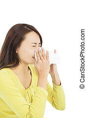 mulher jovem, usando, um, tecido, e, nariz soprando