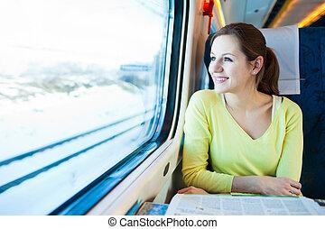 mulher jovem, viajando, por, trem