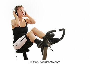 mulher, ligado, girar, bicicleta, com, fones