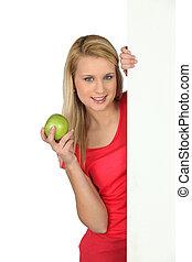 mulher, maçã, atrás de, segurando, branca, painel