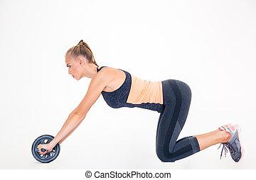 mulher, malhação, com, exercícios, roda