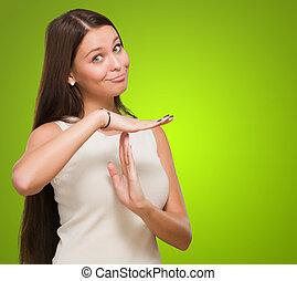 mulher, mostrando, jovem, tempo, retrato, sinal, saída