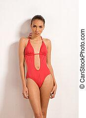 mulher, pedaço, um, étnico, swimsuit, creole, vermelho