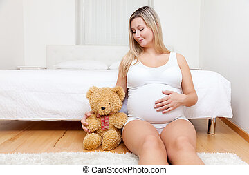 mulher, pelúcia, grávida, jovem, urso, chão, sentando