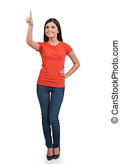 mulher, pointing., duração cheia, de, alegre, mulher jovem, apontar, afastado, e, sorrindo, enquanto, ficar, isolado, branco