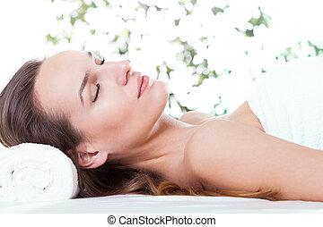 mulher relaxando, ligado, tabela massagem