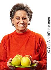 mulher sênior, maçãs