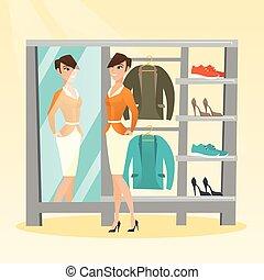 mulher, sala, casaco, vestindo, tentando, caucasiano