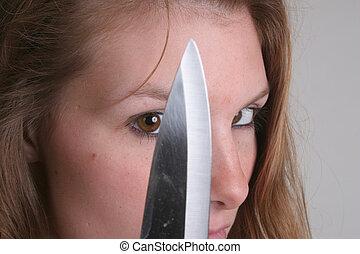 mulher segura, faca