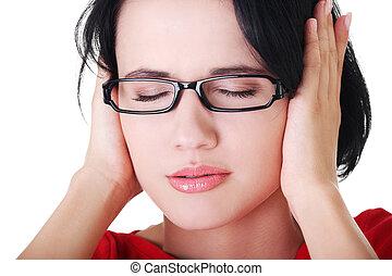 mulher segura, jovem, orelhas, dela, frustrado