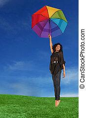 mulher segura, um, guarda-chuva, queda, de, a, céu