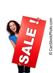 mulher sorri, mostrando, vermelho, sinal venda, billboard,...