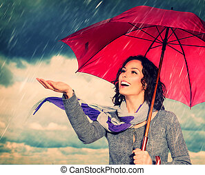 mulher sorridente, com, guarda-chuva, sobre, outono, chuva,...
