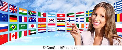 mulher sorridente, mostra, bandeiras internacionais