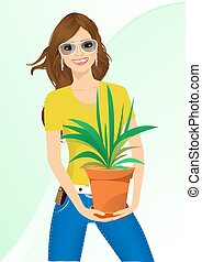 mulher sorridente, segurando, chlorophytum