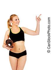 mulher, tapete, apontar, atlético, jovem, algo, segurando