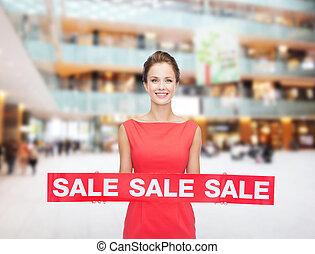 mulher, venda, jovem, sinal, sorrindo, vestido, vermelho