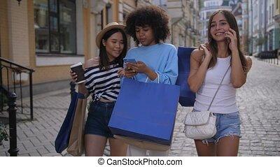 Mulitiracial friends enjoying shopping together