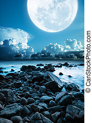 Mull moon over the rocky coast