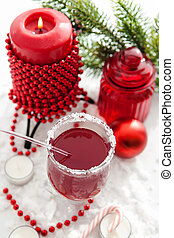 Mulled wine and candle with Christmas decorations around