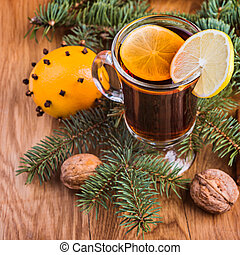 Mulled wine for winter and Christmas with spices and orange and walnuts