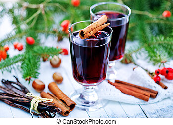 mulled wine in glass and on a table