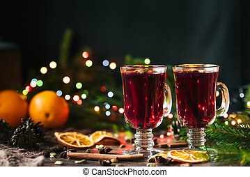 mulled wine in glasses on the table with Christmas decor