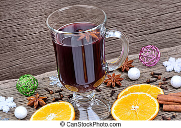 Mulled wine with christmas decoration on table