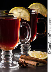 mulled wine with lemon on a dark background