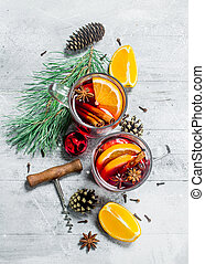 Mulled wine with spices and orange slices.
