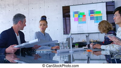 Mult-ethnic business people discussing over blueprint in the conference room at modern office 4 4k