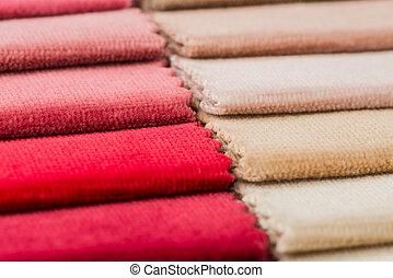 Closeup detail of multi color fabric texture samples.