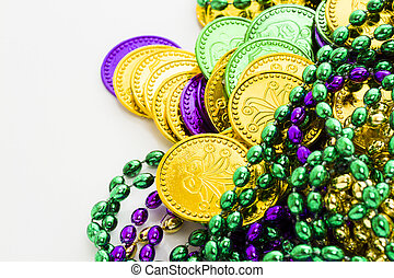 Mardi Gras - Multi color Mardi Gras beads and tokens on...