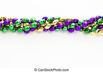 Multi color Mardi Gras beads on white background.