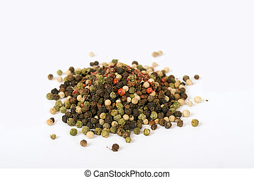multi color pepper seeds isolated over a white background
