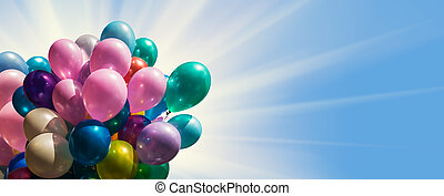 Multi-colored balloons against blue sky with sun light