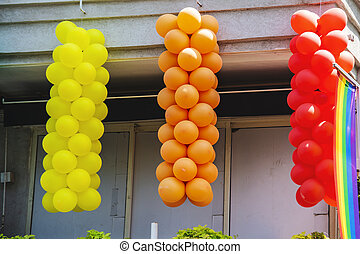 Multi Colored balloons hang on the balcony in Tel Aviv, Israel.