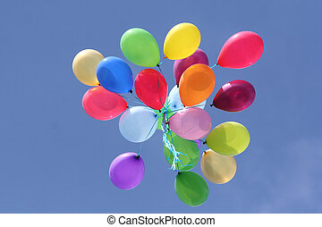 Multi colored balloons in blue sky