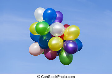 Multi colored balloons in the sky